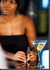 Woman at bar with martini